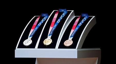 Гар утасны хаягдалд сануулга өгсөн олимпийн медаль